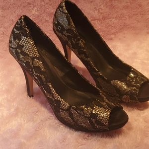 High heeled black and gold open toe shoes